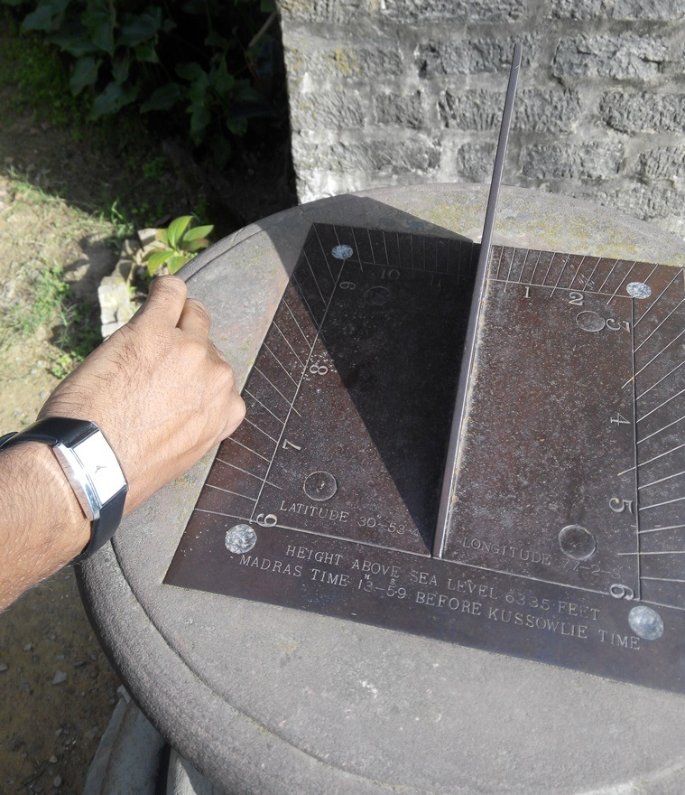 sundial and watch